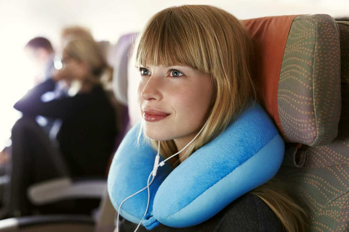Beautiful female passenger on airplane | Travel Tips For The Newbie International Traveler