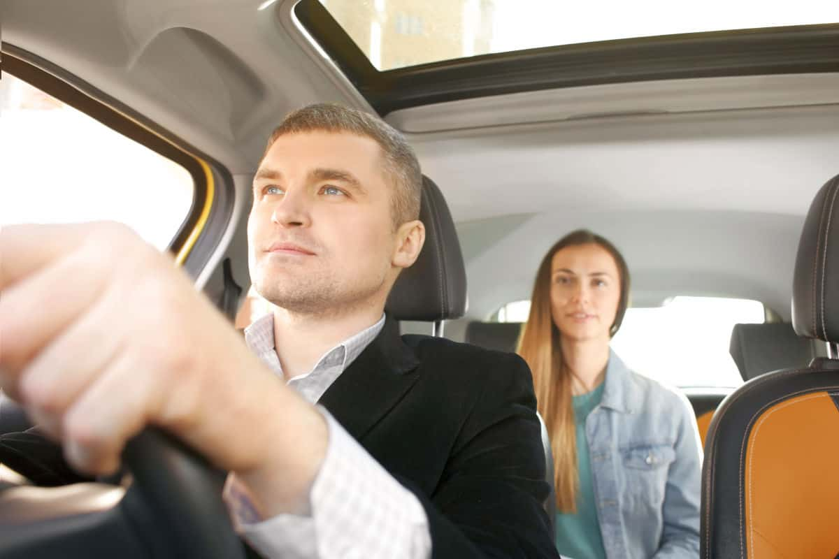 Male driver and female passenger in car | Travel Tips For The Newbie International Traveler