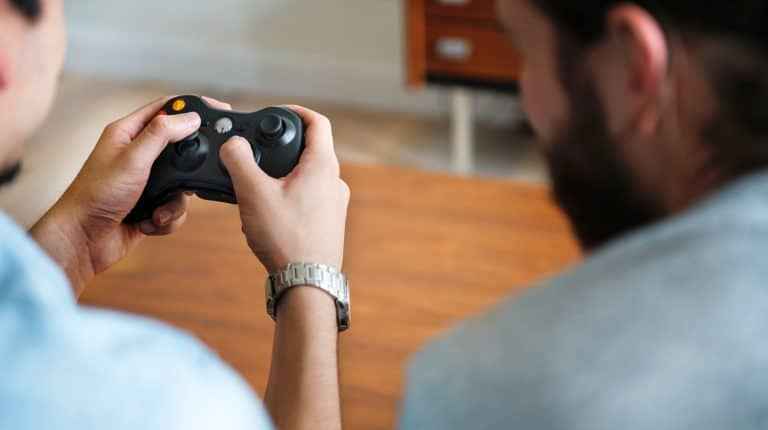 Feature | Person holding gamepad xbox | What To Expect From The XBox Two