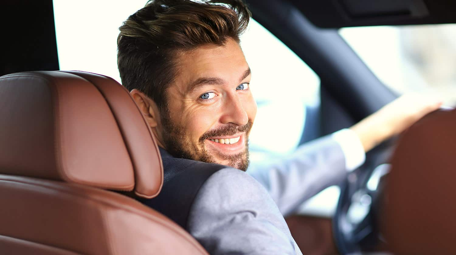Feature | Portrait of an handsome smiling business man driving his car | Cool Car Gadgets On Amazon