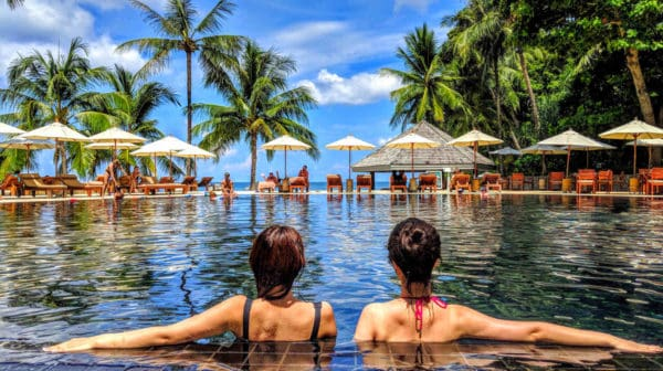 Feature | Two woman on Infinity pool | Waterproof Gadgets To Lounge By The Pool With