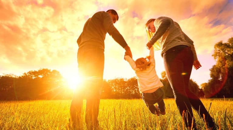 Feature   Happy family in the park evening light   Best Family Safety Gadgets, Apps and Digital Books