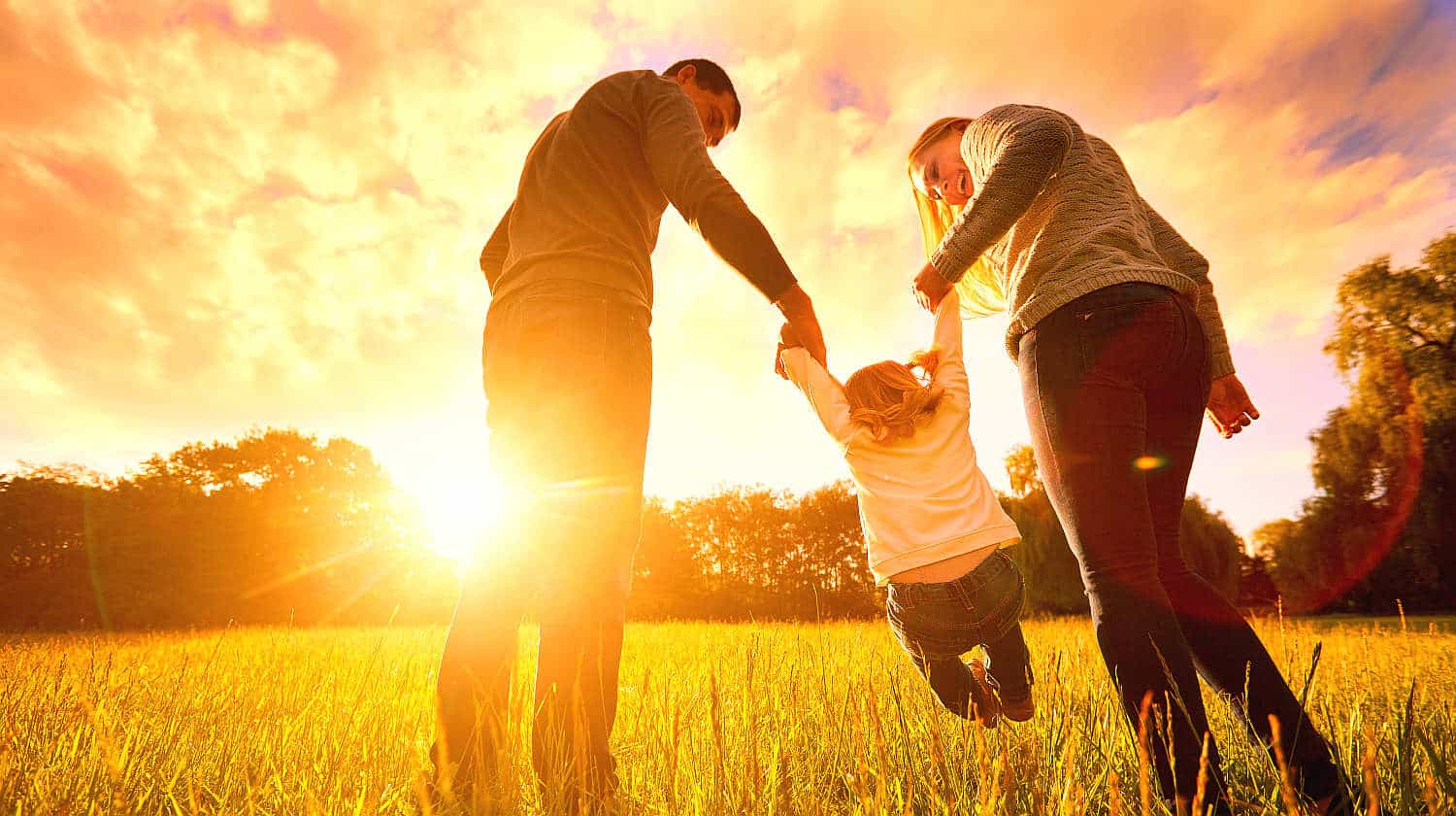 Feature | Happy family in the park evening light | Best Family Safety Gadgets, Apps and Digital Books