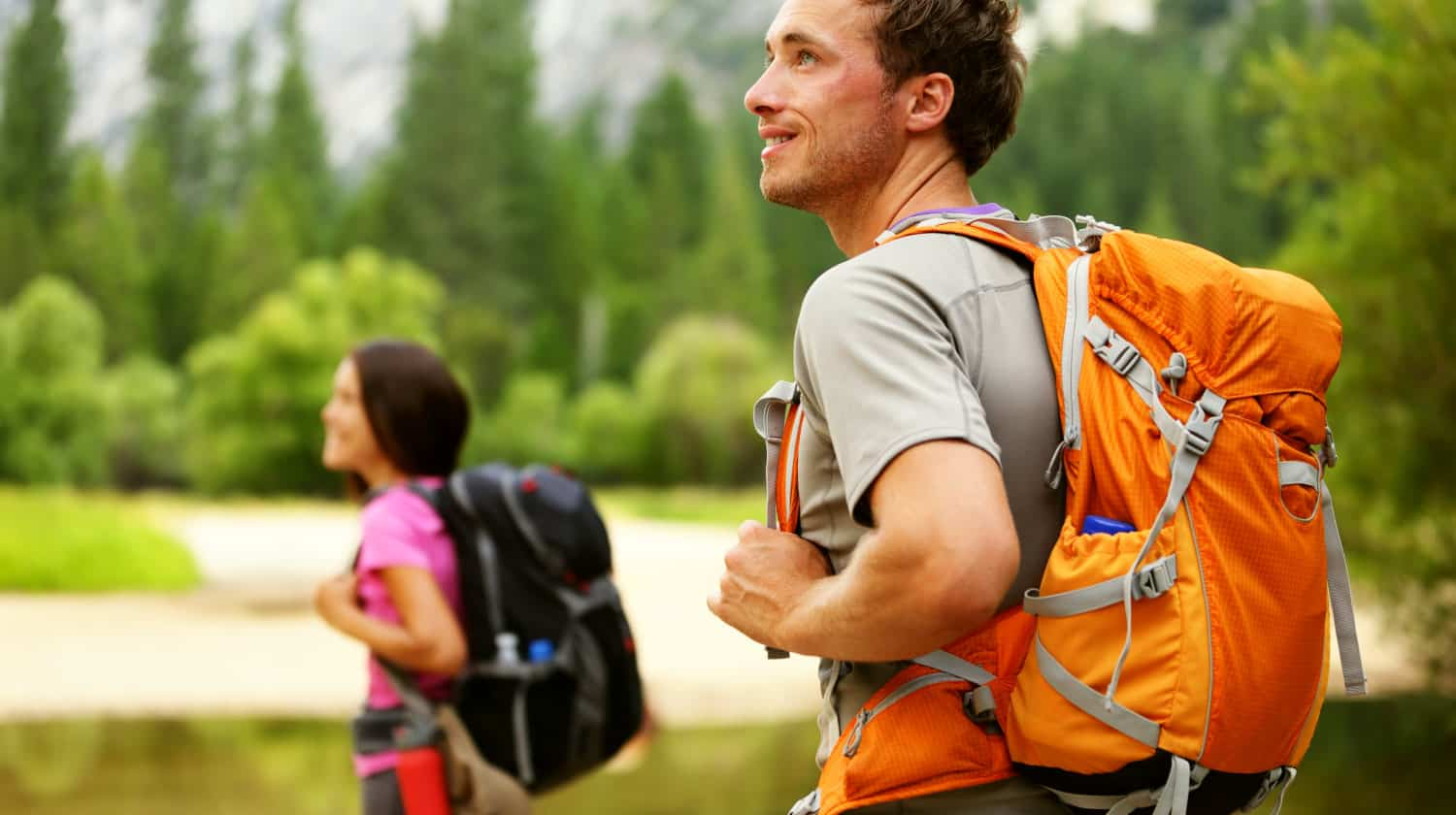 Featured | Hikers - people hiking, man looking at mountain | Outdoor Survival Gear And Gadgets on Amazon Under $100