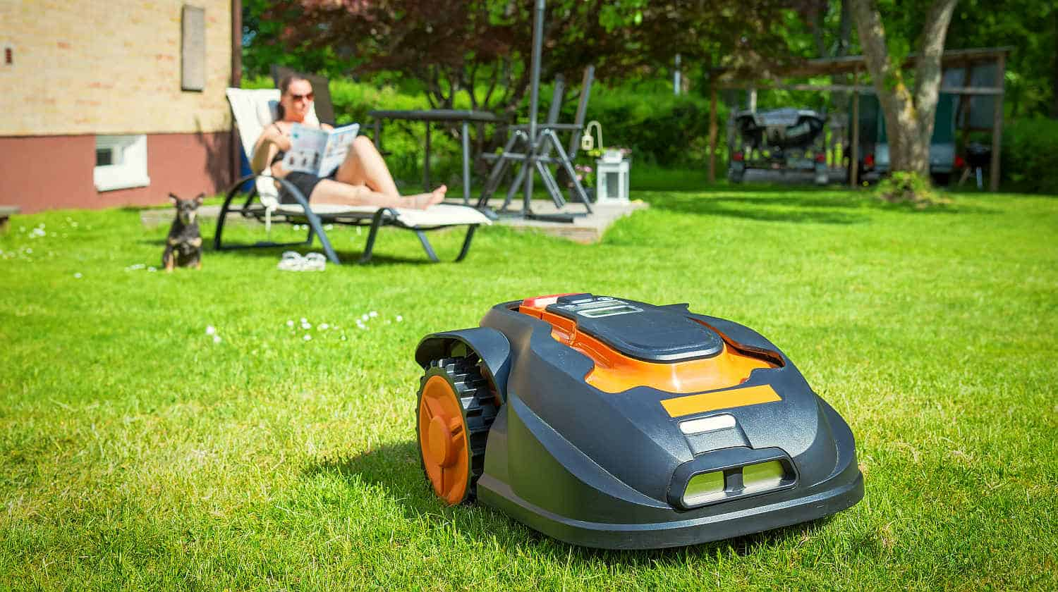 Automatic lawnmower in modern garden | Robotic Lawn Mowers and Other Smart Gadgets for the (Hard) Yard Work | best lawn mower | Featured