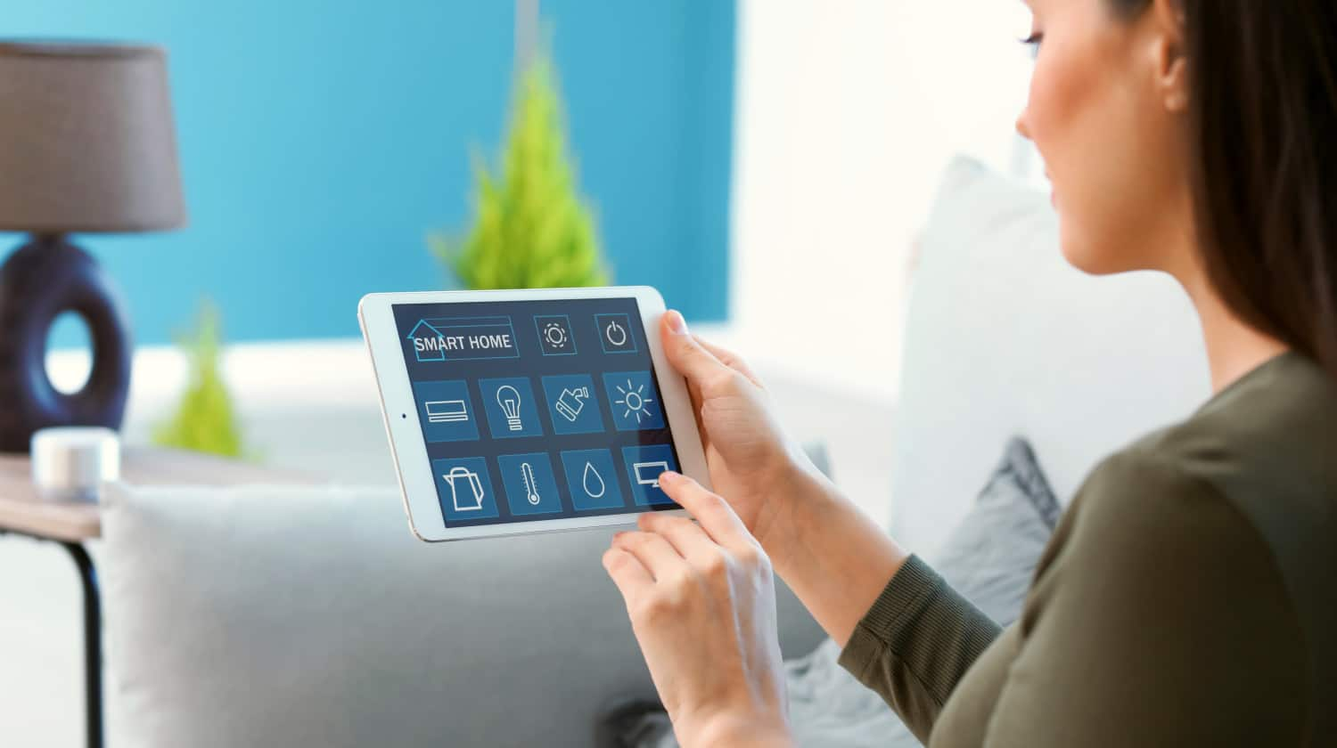 A couple sitting on the sofa controls all the functions | DIY Smart Home Automation Guide: Best Smart Devices From Amazon | diy smart home security | Featured