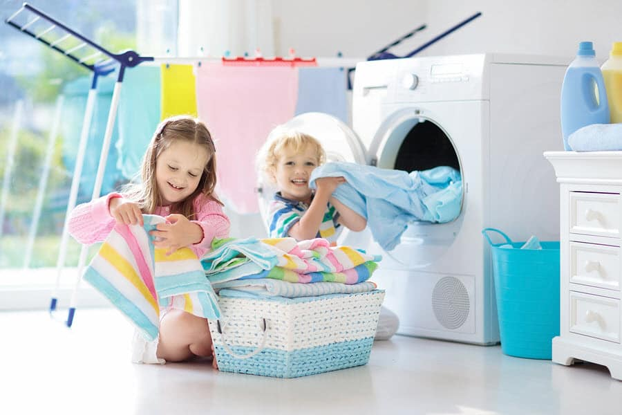 Kids doing chores in laundry room