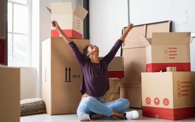 Woman moving, raising arms in joy