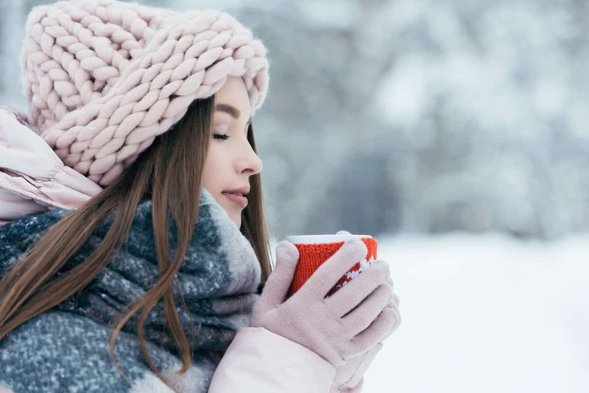 Woman with winter gadgets